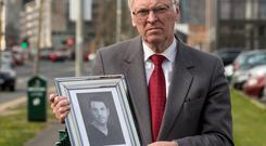 Cllr Charlie O'Connor holding a picture of his late son Robert Picture:Arthur Carron