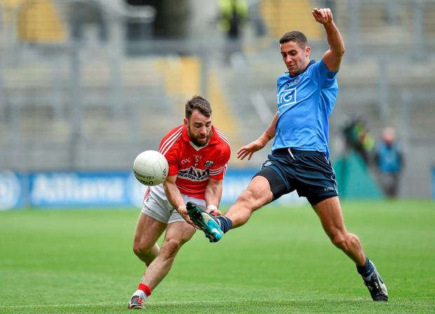 James McCarthy, Dublin, in action against Colm O'Driscoll, Cork