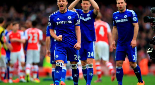 Chelsea's John Terry celebrates the draw after the game during the Barclays Premier League match at the Emirates