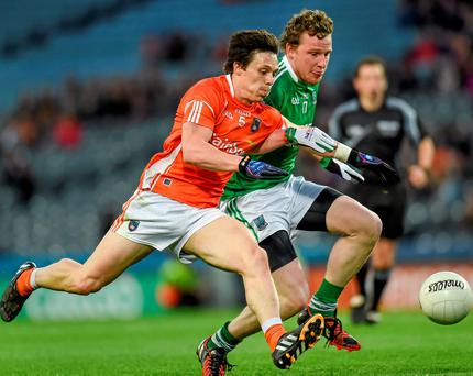 James Morgan of Armagh in a race for the ball with Fermanagh's Aidan Breen during Saturday's Division 3 Final
