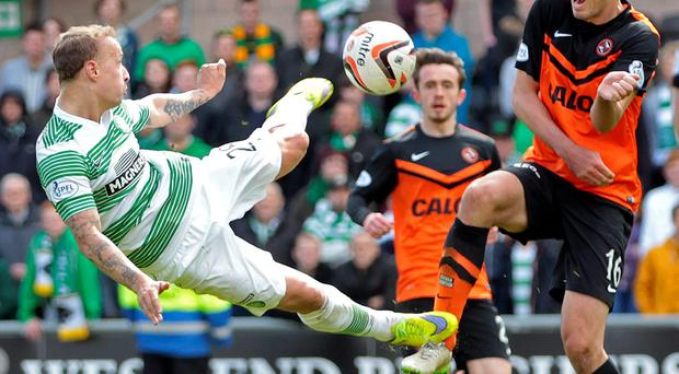 Celtic hat-trick hero Leith Griffiths puts his best foot forward against Ryan McGowan
