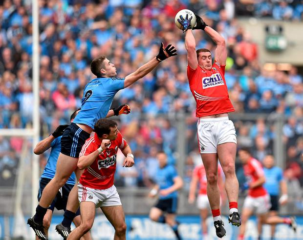 Fintan Goold of Cork makes a brilliant catch ahead of Dublin's Brian Fenton
