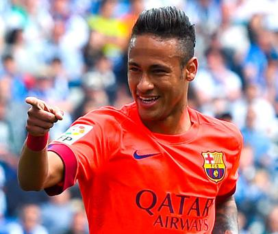 Neymar followed his two goals against Paris Saint-Germain in the Champions League on Tuesday by slotting home after 17 minutes in Barcelona's 2-0 victory over Espanyol on Saturday