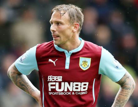 Burnley's Matt Taylor looks dejected after missing his penalty against Leicester on Saturday