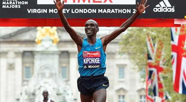 Eliud Kipchoge of Kenya celebrates after winning the Men's race during the Virgin Money London Marathon