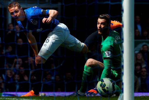 James McCarthy opens the scoring for Everton against Man United's David de Gea