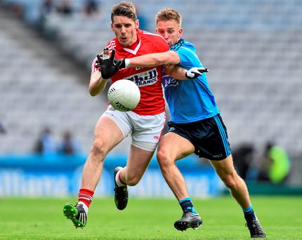Cork's Daniel Goulding is tackled by Jonny Cooper of Dublin