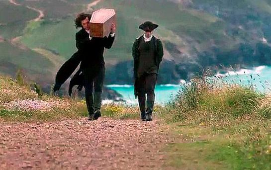 Ross Poldark walks the path carrying his daughter's coffin on his shoulder Photo: BBC