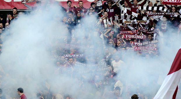 Torino's supporters look on as a firework explode during their Italian Serie A soccer match against Juventus at Olympic Stadium in Turin April 26, 2015. REUTERS/Giorgio Perottino