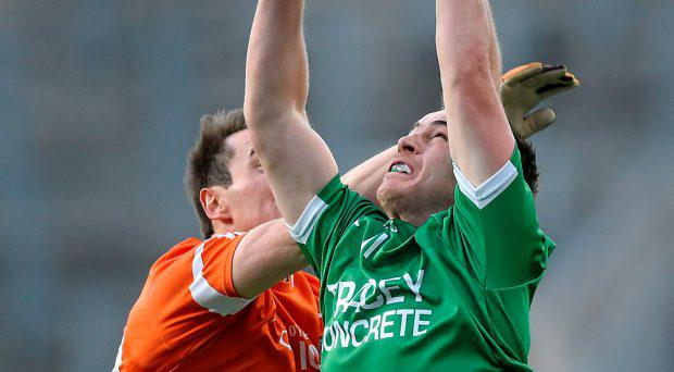 Ruairi Corrigan, Fermanagh, in action against Tony Kernan, Armagh