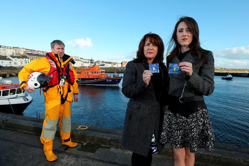 Portrush RNLI mechanic Anthony Chambers alongside Sally and Eimear McDaid from Donegal who are helping to raise funds for the lifeboat charity. Photo: RNLI/PA Wire