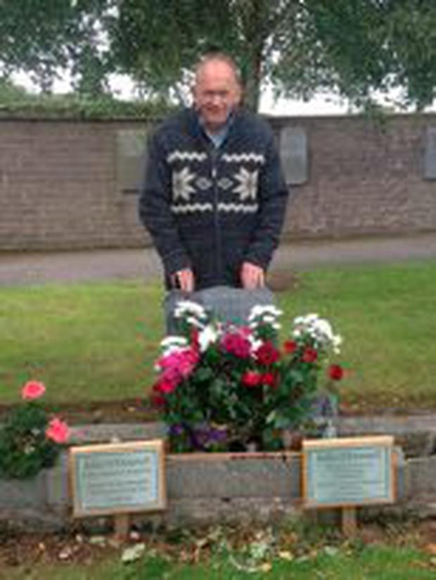 Frederick O'Donnell at the grave of his mother Julia O'Donnell