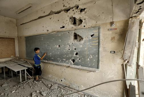 Seven schools were targeted by Israel during the 2014 Gaza war Credit: Ted Botha