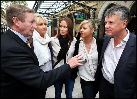 Taoiseach Enda Kenny with, Audrey Morgan (far left) and her husband Enda Morgan (far right), from Rathfarnham and their daughter Rachel (second from right) with her partner Marion Doherty, from Donegal, at the launch of Fine Gael's Vote Yes campaign at the Gaiety Theatre in Dublin
