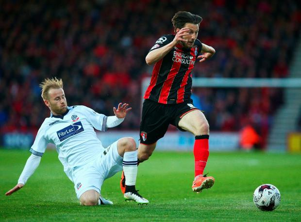 Harry Arter evades Barry Bannan of Bolton Wanderers during the Sky Bet Championship match between AFC Bournemouth and Bolton Wanderers