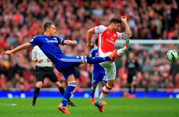 Chelsea's John Terry (left) and Arsenal's Olivier Giroud in action during the Barclays Premier League match at the Emirates Stadium, London on Sunday (Nick Potts/PA Wire)