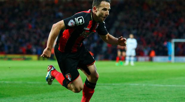 Marc Pugh turns away to celebrate after putting Bournemouth ahead