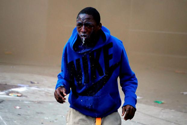 A demonstrator looks up after being sprayed with pepper spray during clashes in Baltimore, Maryland. Photo: Reuters