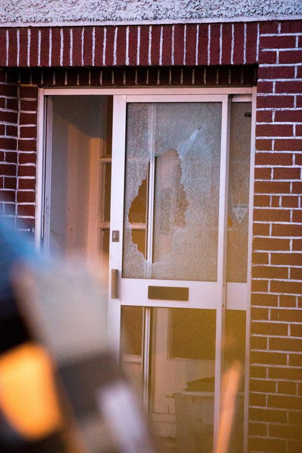 The couple's smashed front door
