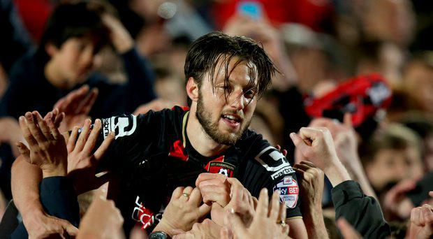 Bournemouth's Harry Arter celebrates with fans on the pitch