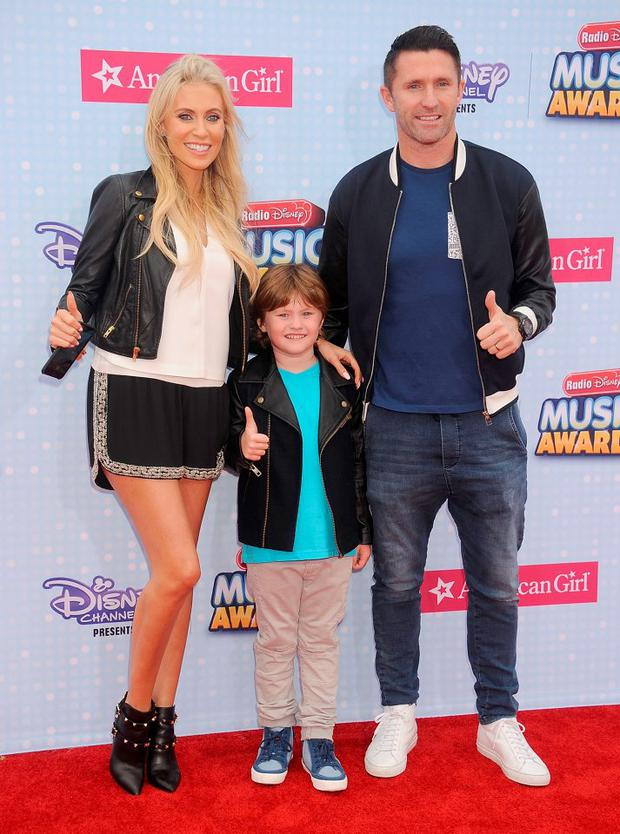 L.A. Galaxy player Robbie Keane, wife Claudine Palmer and son Robert Ronan Keane arrive at the 2015 Radio Disney Music Awards at Nokia Theatre L.A. Live on April 25, 2015 in Los Angeles, California. (Photo by Gregg DeGuire/WireImage)