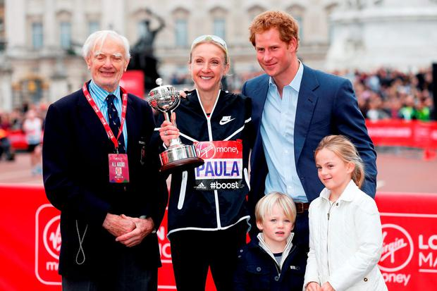 Paula Radcliffe of Great Britain poses with John Disley (L), Prince Harry (R) and her children after receiving the inaugural John Disley London Marathon Lifetime Achievement Award during the Virgin Money London Marathon on April 26, 2015 in London, England. (Photo by Steve Bardens/Getty Images)