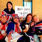 (From the left) Royal fans Terry Hutt, John Loughry, Kathy Martin, Maria Scott and Amy Thompson (at the back) enjoy a luxury pastries sent to them by Kensington Palace, as they wait outside the Lindo Wing in London where the Duchess of Cambridge is due to give birth