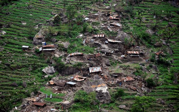 Damaged houses are seen from an Indian Army helicopter following an earthquake in the Nepal Credit: Sajjad Hussain