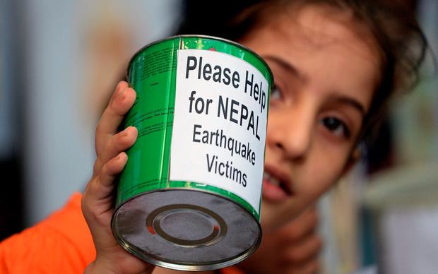An Indian school child collects funds for victims of the devastating earthquake in Nepal Credit: Indranil Mukerjee