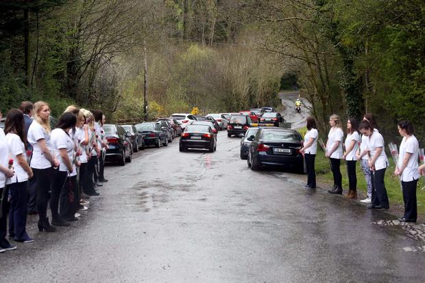 28/04/15 Nurses from Karen Buckley's graduation class at University of Limerick Hospita form a guard of honour for the funeral cortage pictured this afternoon at the funeral of Karen Buckley who died in Glasgow over two weeks ago. Her funeral took place at at the Church of St Michael the Archangel in Analeentha in Mourneabbey, Co. Cork. Picture Colin Keegan, Collins Dublin.
