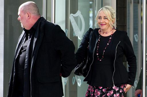Gail O'Rorke with her husband Barry at Dublin Circuit Criminal Court where she was found not guilty aiding, abetting, counselling or procuring the suicide of Bernadette Forde. Pic: Courts Collins.