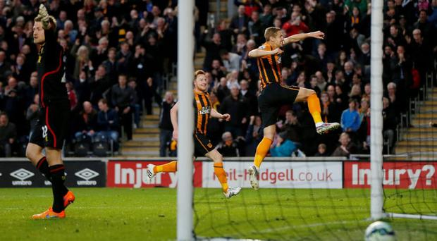 Michael Dawson celebrates after scoring against Liverpool