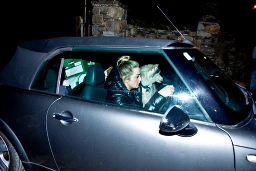 Blaise O'Donnell, daughter of solicitor Brian O'Donnell, leaving her home with two dogs packed into her car ahead of tomorrow's deadline to move out of his Gorse Hill property in Killiney.