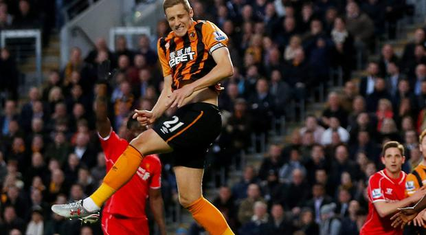 Michael Dawson heads home the winning goal for Hull against Liverpool last night