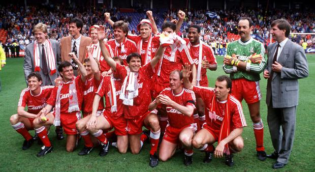 The Liverpool first-team squad celebrate after winning the League in 1990 after defeating QPR 2-1, 25 years ago yesterday