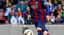 Lionel Messi scores a 'Panenka' penalty during Barcelona's crushing victory over Getafe