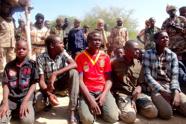 Former members of insurgent group Boko Haram gather in front of Chadian soldiers in Ngouboua, Chad, April 22, 2015. Picture taken April 22, 2015. REUTERS/Moumine Ngarmbassa