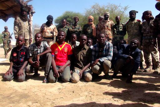 Former members of insurgent group Boko Haram gather in front of Chadian soldiers in Ngouboua, Chad, April 22, 2015. REUTERS/Moumine Ngarmbassa