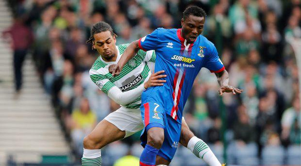 Inverness Caledonian's Edward Ofere and Celtic's Jason Denayer in action