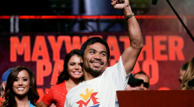 Boxer Manny Pacquiao, of the Philippines, greets fans at a rally in Las Vegas