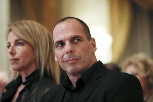 Greek Finance Minister Yanis Varoufakis and his wife Danae Stratou attend a banking conference in Athens April 21, 2015. REUTERS/Alkis Konstantinidis