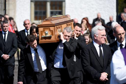 Shane Mulholland's remains are carried out of St Ninnidh's Church, Derrylin by family members and friends