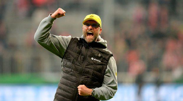 Dortmund's headcoach Juergen Klopp celebrates after the German Cup DFB Pokal semi-final football match FC Bayern Munich v Borussia Dortmund in Munich