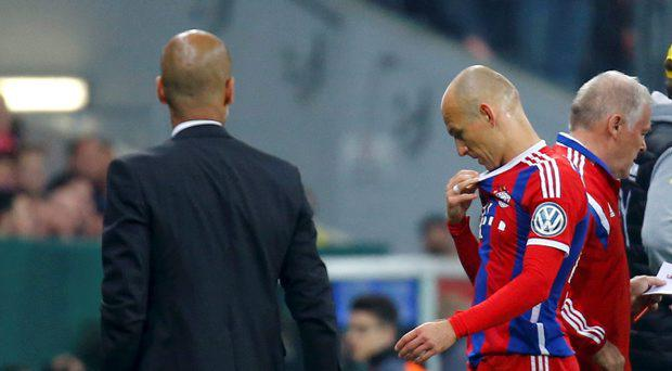 Bayern Munich's Arjen Robben walks past coach Pep Guardiola
