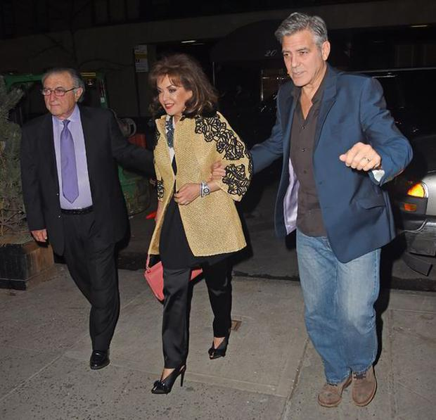 George puts a protective arm around Baria Alamuddin as she and her husband Ramzi join the Clooneys for dinner