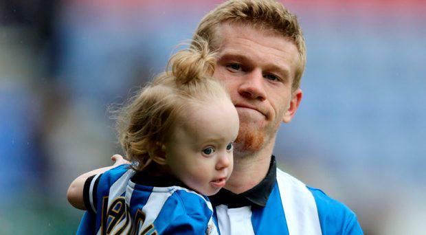 Wigan's James McClean with his daughter after the Sky Bet Championship match at the DW Stadium, Wigan