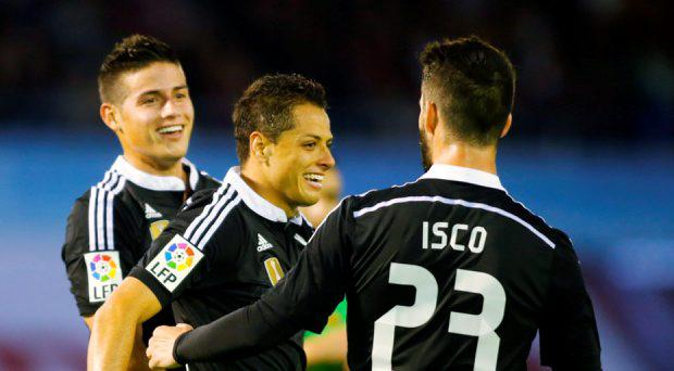 Real Madrid's James Rodriguez (L) celebrates his goal against Celta Vigo with teammates Javier Hernandez