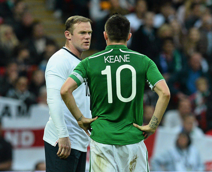 Robbie Keane in conversation with Wayne Roone during the 2013 international friendly at Wembley Stadium.