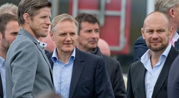 Ireland head coach Joe Schmidt at the Punchestown racecourse with forwards coach Simon Easterby and scrum coach Greg Feek, right