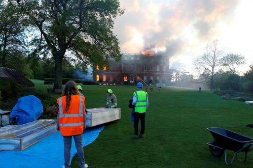 Dozens of firefighters battle a blaze at Clandon Park, an 18th century National Trust property near Guildford in Surrey. Photo: Steve Parsons/PA Wire